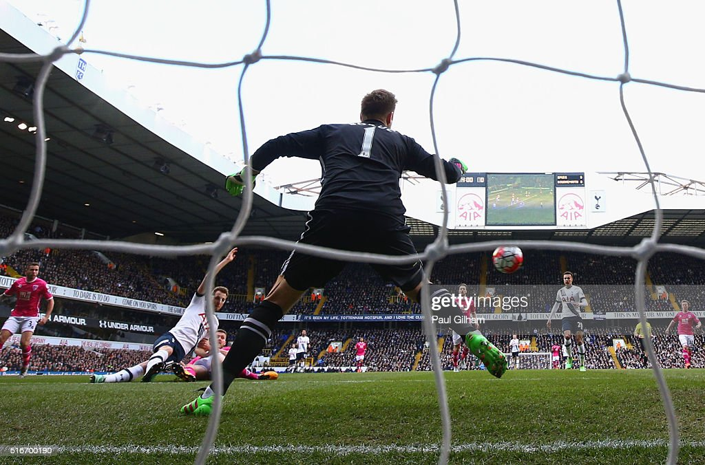 Harry Kane of Tottenham Hotspur beats goalkeeper Artur Boruc of Bournemouth to score their first goal during the Barclays Premier League match between Tottenham Hotspur and A.F.C. Bournemouth at White Hart Lane on March 20, 2016 in London, United Kingdom.