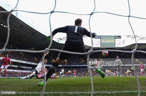 Harry Kane of Tottenham Hotspur beats goalkeeper Artur Boruc of Bournemouth to score their first goal during the Barclays Premier League match...