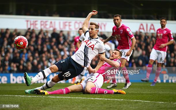 Harry Kane of Tottenham Hotspur beats Simon Francis of Bournemouth to score their first goal during the Barclays Premier League match between...
