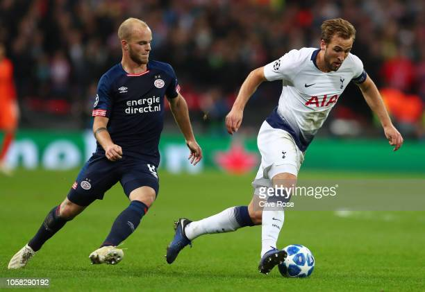 Harry Kane of Tottenham Hotspur breaks away from Jorrit Hendrix of PSV Eindhoven during the Group B match of the UEFA Champions League between...