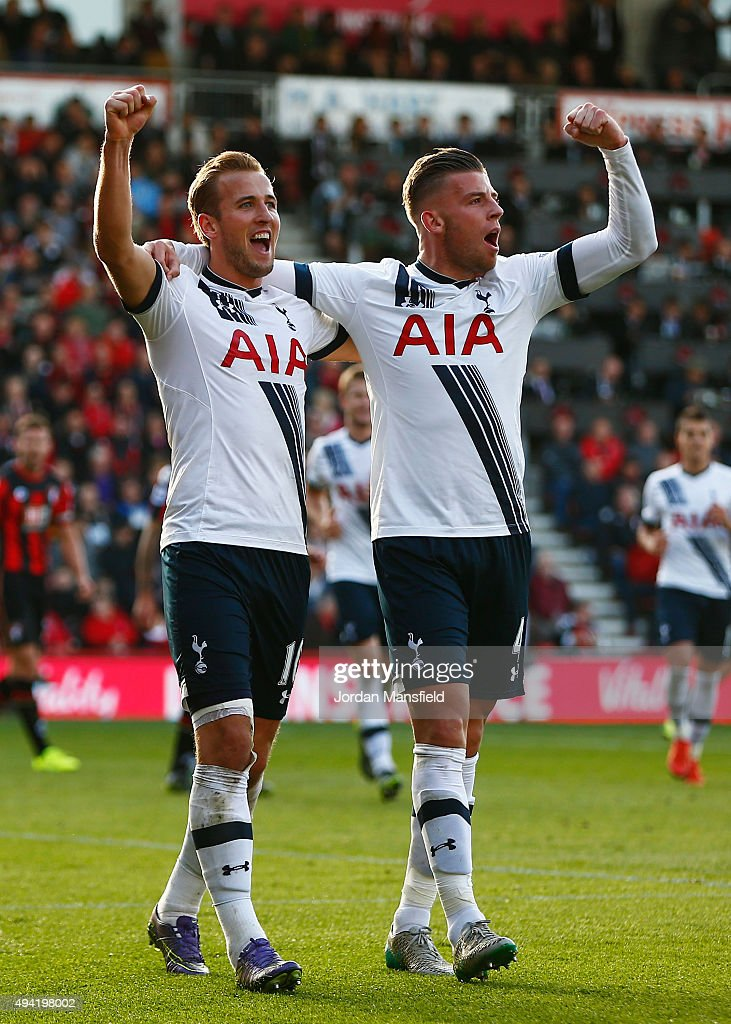 Harry Kane (L) of Tottenham Hotspur celeberates scoring his team's fifth and hat trick goal with his team mate Toby Alderweireld (R) during the Barclays Premier League match between A.F.C. Bournemouth and Tottenham Hotspur at Vitality Stadium on October 25, 2015 in Bournemouth, England.