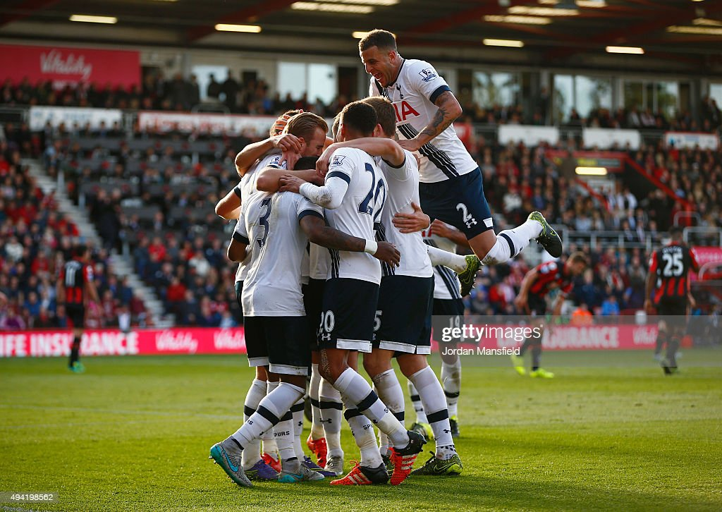 Harry Kane (1st L) of Tottenham Hotspur celeberates scoring his team's fifth and hat trick goal with his team mates during the Barclays Premier League match between A.F.C. Bournemouth and Tottenham Hotspur at Vitality Stadium on October 25, 2015 in Bournemouth, England.