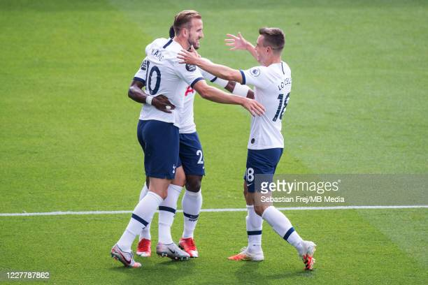 Harry Kane of Tottenham Hotspur celebrate with his teammates Giovani Lo Celso and Harry Winks after scoring 1st goal during the Premier League match...