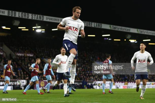 Harry Kane of Tottenham Hotspur celebrates after he scores his sides first goal from the penalty spot during the Premier League match between Burnley...