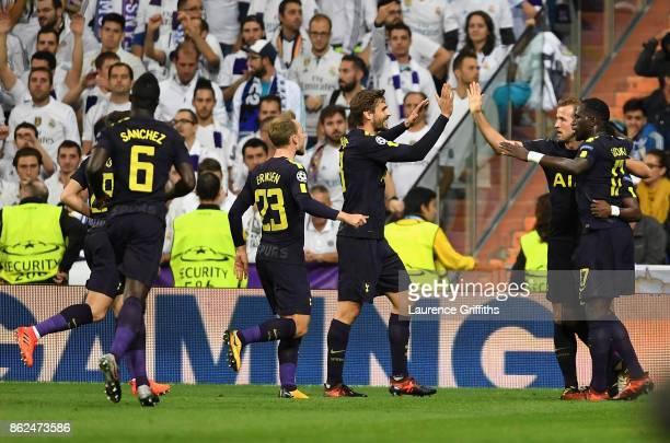 Harry Kane of Tottenham Hotspur celebrates after Raphael Varane of Real Madrid scores a own goal for Tottenham Hotspur with his Tottenham Hotspur...