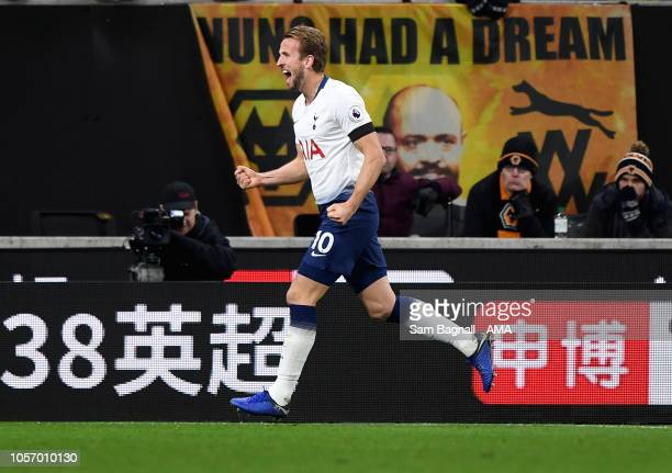 Harry Kane of Tottenham Hotspur celebrates after scoring a goal to make it 03 during the Premier League match between Wolverhampton Wanderers and...