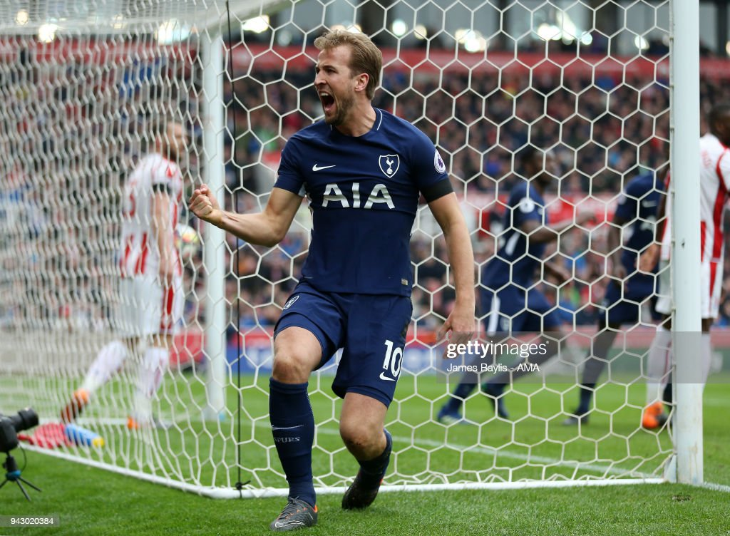 Harry Kane of Tottenham Hotspur celebrates after scoring a goal to make it 1-2 during the Premier League match between Stoke City and Tottenham Hotspur at Bet365 Stadium on April 7, 2018 in Stoke on Trent, England.