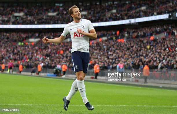 Harry Kane of Tottenham Hotspur celebrates after scoring his hattrick goal to make it 51 during the Premier League match between Tottenham Hotspur...
