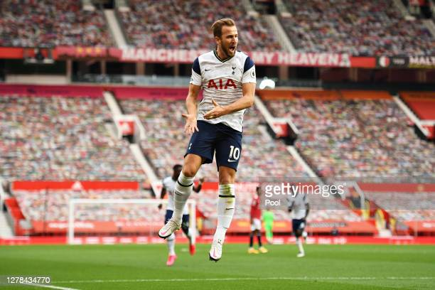 Harry Kane of Tottenham Hotspur celebrates after scoring his sides third goal with teammates Erik Lamela and Moussa Sissoko during the Premier League...