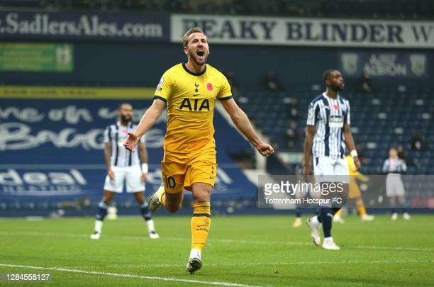 Harry Kane of Tottenham Hotspur celebrates after scoring his sides first goal during the Premier League match between West Bromwich Albion and...