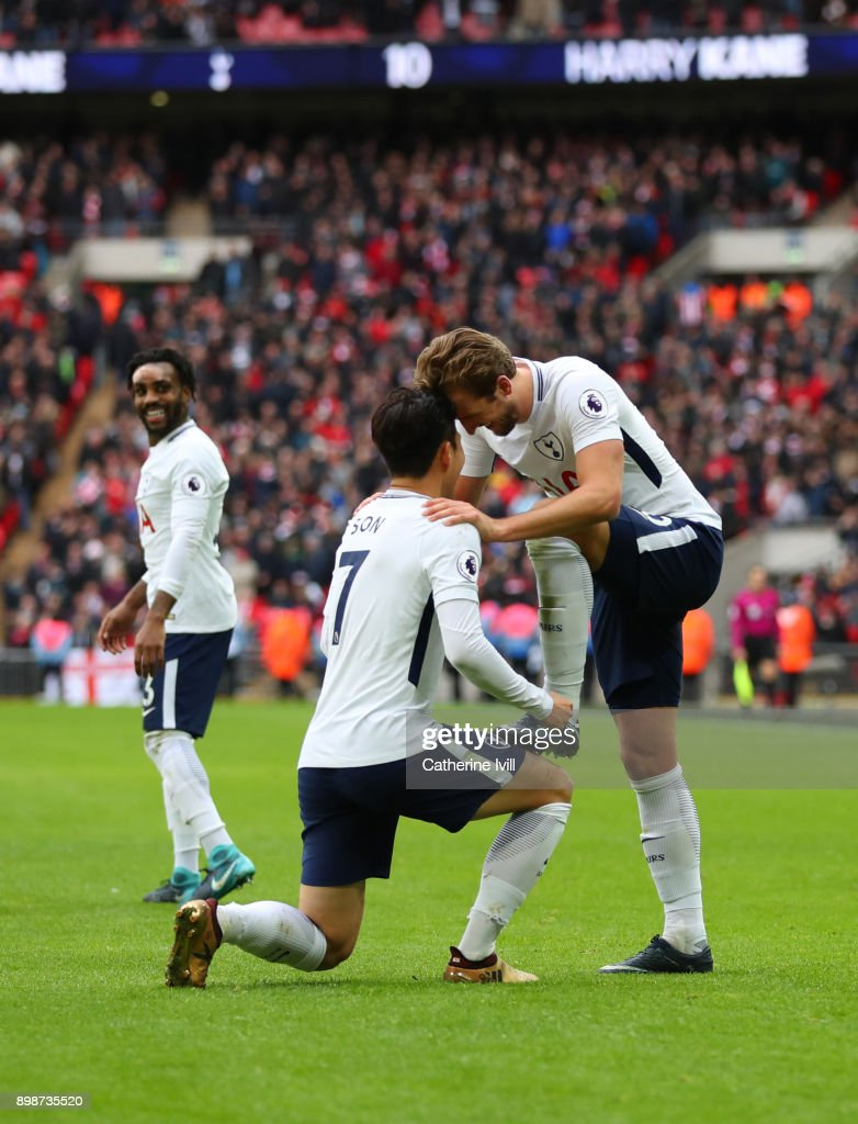 Harry Kane of Tottenham Hotspur celebrates after scoring his sides fifth goal and his hat-trick with Heung-Min Son of Tottenham Hotspur during the Premier League match between Tottenham Hotspur and Southampton at Wembley Stadium on December 26, 2017 in London, England.