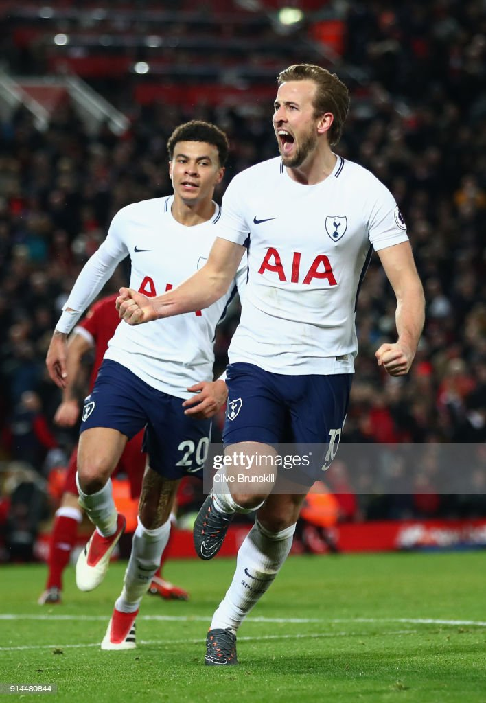 Harry Kane of Tottenham Hotspur celebrates after scoring his sides second goal and his 100th Premier League goal during the Premier League match between Liverpool and Tottenham Hotspur at Anfield on February 4, 2018 in Liverpool, England.