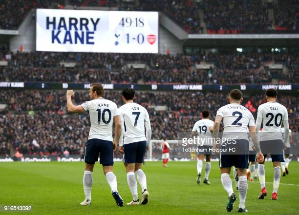Harry Kane of Tottenham Hotspur celebrates after scoring his sides first goal during the Premier League match between Tottenham Hotspur and Arsenal...