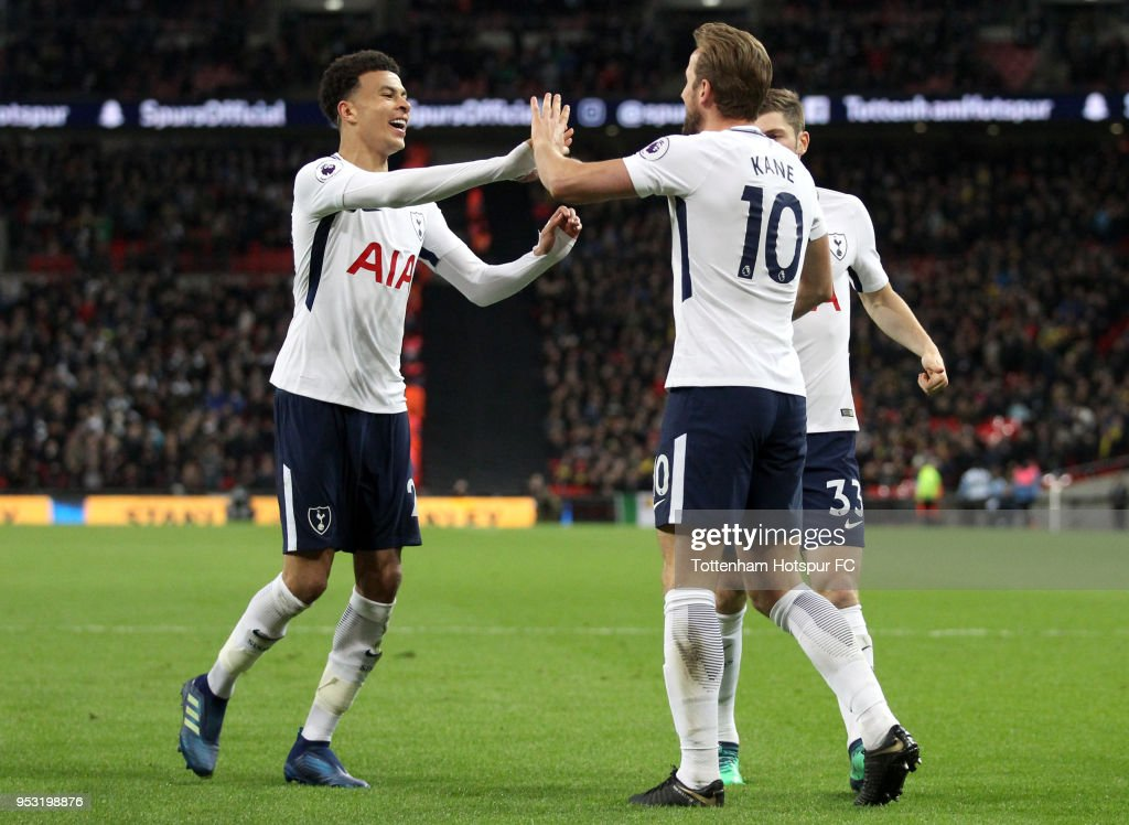Harry Kane of Tottenham Hotspur celebrates after scoring his sides second goal with Dele Alli of Tottenham Hotspur and Ben Davies of Tottenham Hotspur during the Premier League match between Tottenham Hotspur and Watford at Wembley Stadium on April 30, 2018 in London, England.