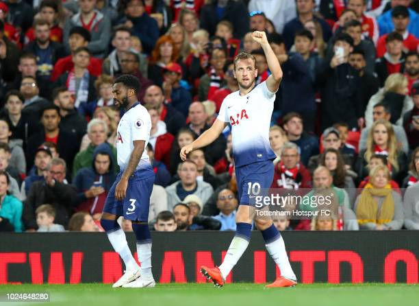Harry Kane of Tottenham Hotspur celebrates after scoring his team's first goal during the Premier League match between Manchester United and...