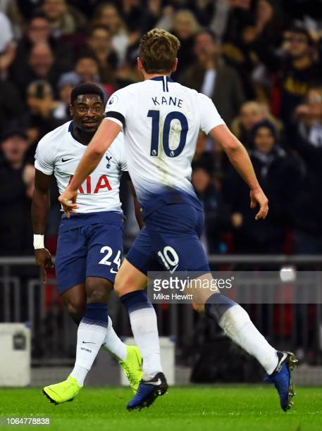 Harry Kane of Tottenham Hotspur celebrates after scoring his team's second goal with Serge Aurier of Tottenham Hotspur during the Premier League...