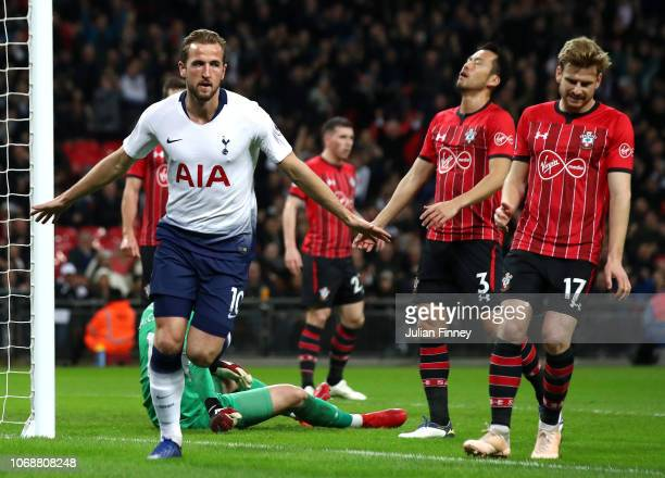 Harry Kane of Tottenham Hotspur celebrates after scoring his team's first goal during the Premier League match between Tottenham Hotspur and...