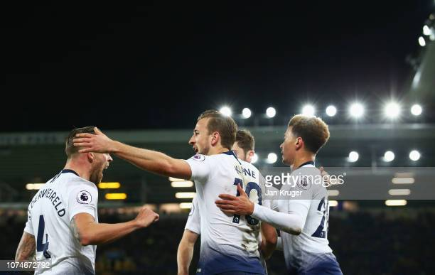 Harry Kane of Tottenham Hotspur celebrates after scoring his team's third goal with team mates during the Premier League match between Everton FC and...