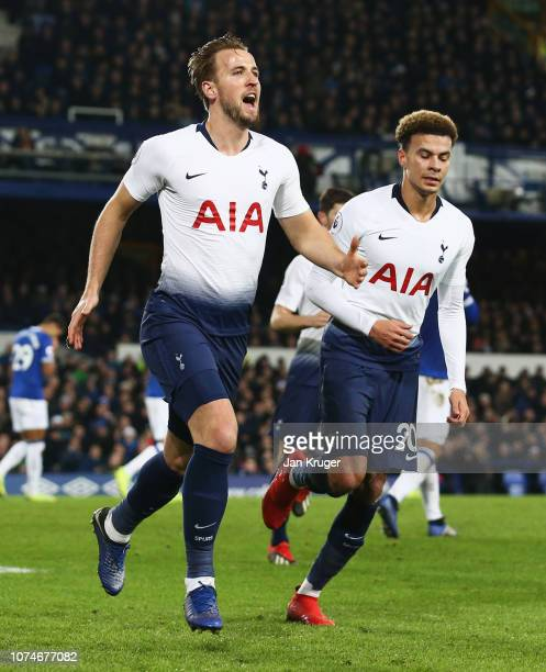 Harry Kane of Tottenham Hotspur celebrates after scoring his team's third goal with team mate Dele Alli during the Premier League match between...