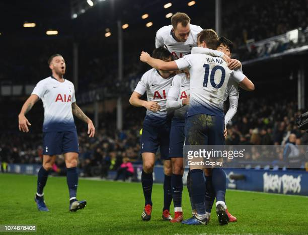 Harry Kane of Tottenham Hotspur celebrates after scoring his team's sixth goal with Christian Eriksen and team mates during the Premier League match...