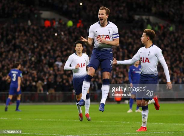 Harry Kane of Tottenham Hotspur celebrates after scoring his team's first goal with Dele Alli of Tottenham Hotspur during the Carabao Cup SemiFinal...