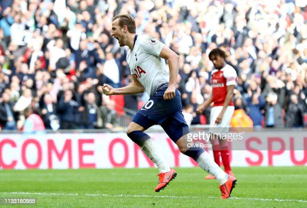 Harry Kane of Tottenham Hotspur celebrates after scoring his team's first goal during the Premier League match between Tottenham Hotspur and Arsenal...