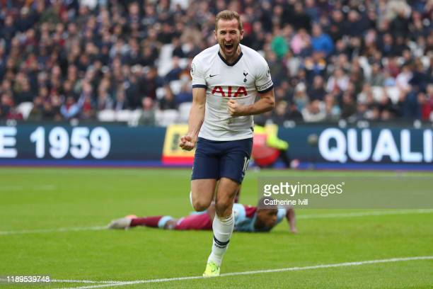 Harry Kane of Tottenham Hotspur celebrates after scoring his team's third goal during the Premier League match between West Ham United and Tottenham...