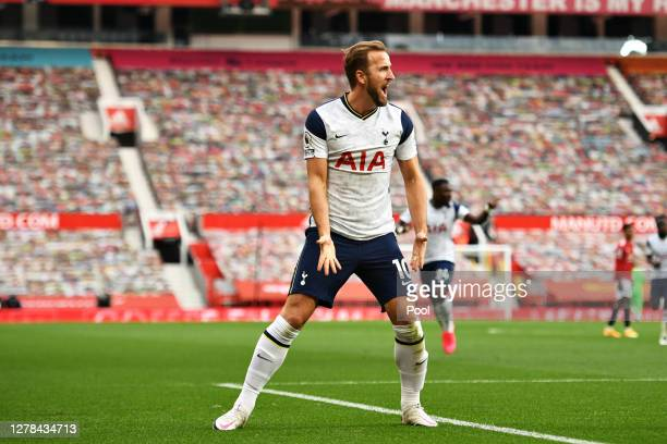 Harry Kane of Tottenham Hotspur celebrates after scoring his team's third goal during the Premier League match between Manchester United and...