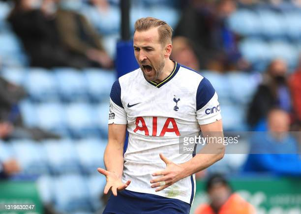 Harry Kane of Tottenham Hotspur celebrates after scoring his team's first goal during the Premier League match between Leicester City and Tottenham...