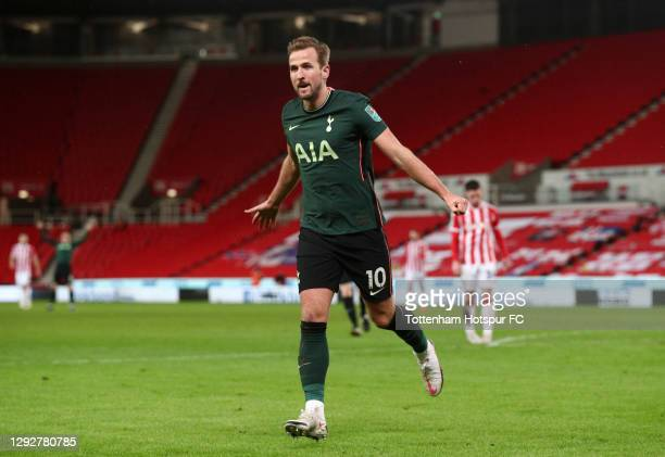 Harry Kane of Tottenham Hotspur celebrates after scoring their sides third goal during the Carabao Cup Quarter Final match between Stoke City and...