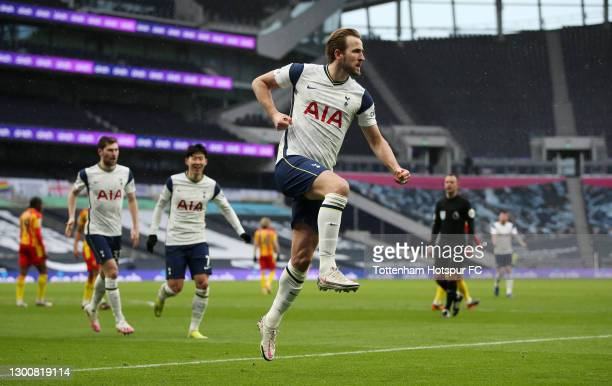 Harry Kane of Tottenham Hotspur celebrates after scoring their side's first goal during the Premier League match between Tottenham Hotspur and West...