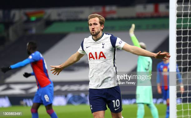 Harry Kane of Tottenham Hotspur celebrates after scoring their sides fourth goal during the Premier League match between Tottenham Hotspur and...