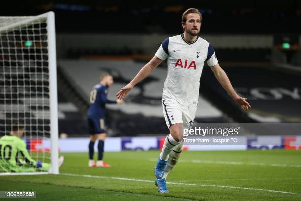 Harry Kane of Tottenham Hotspur celebrates after scoring their side's first goal during the UEFA Europa League Round of 16 First Leg match between...