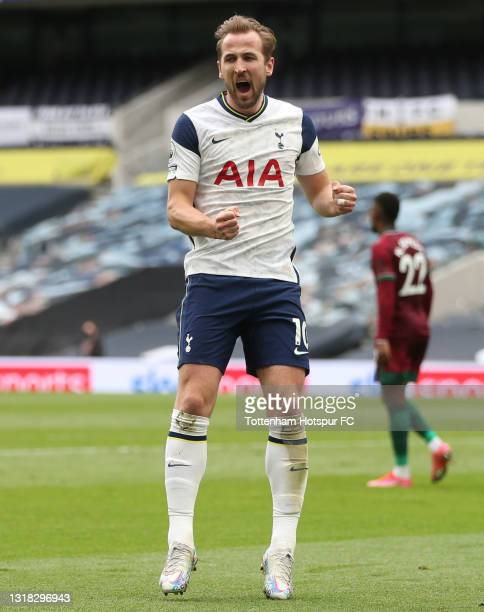 Harry Kane of Tottenham Hotspur celebrates after scoring their side's first goal during the Premier League match between Tottenham Hotspur and...