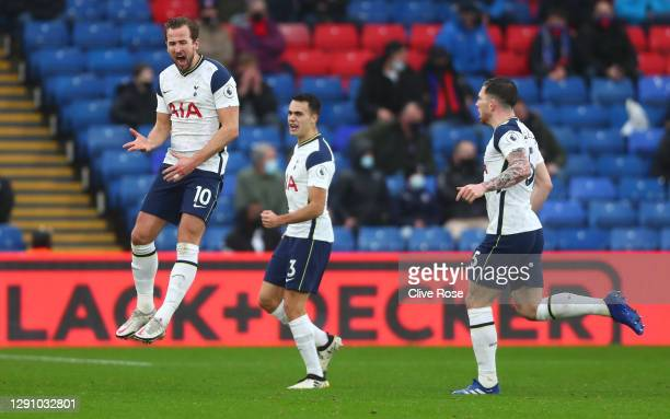 Harry Kane of Tottenham Hotspur celebrates after scoring their team's first goal as Sergio Reguilon and Pierre-Emile Hoejbjerg look on during the...