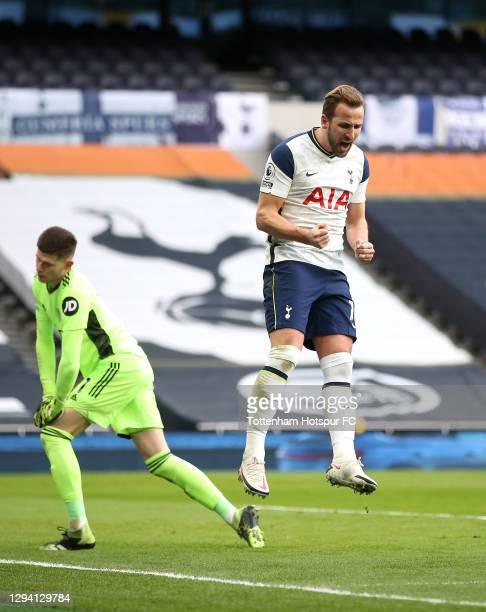 Harry Kane of Tottenham Hotspur celebrates after scoring their team's first goal from the penalty spot as Illan Meslier of Leeds United looks...