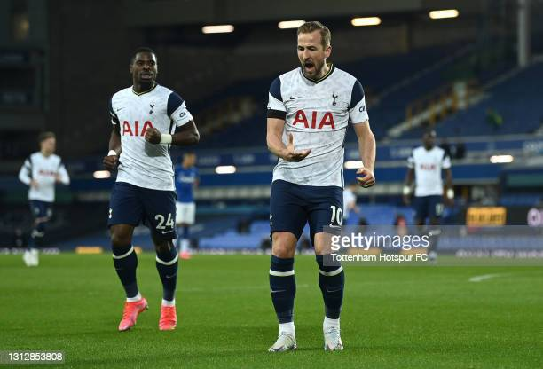 Harry Kane of Tottenham Hotspur celebrates after scoring their team's first goal during the Premier League match between Everton and Tottenham...