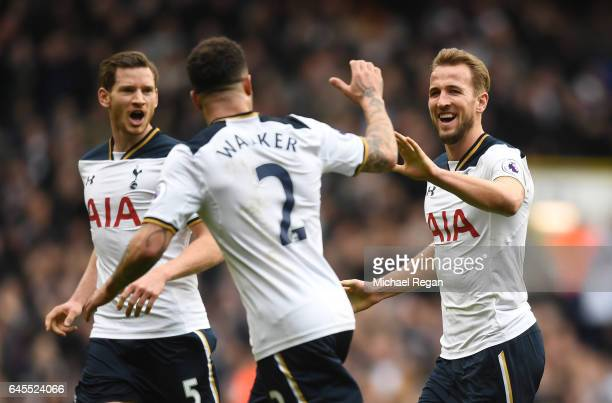 Harry Kane of Tottenham Hotspur celebrates as he scores his teams third goal and completes his hattrick with teammates Kyle Walker and Jan Vertonghen...