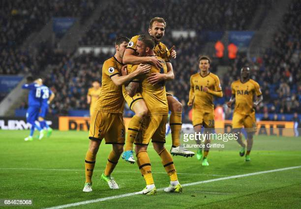 Harry Kane of Tottenham Hotspur celebrates as he scores their third goal with team mates during the Premier League match between Leicester City and...