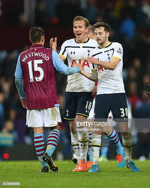 Harry Kane of Tottenham Hotspur celebrates as he shakes hands with Ashley Westwood of Aston Villa at the end of the match