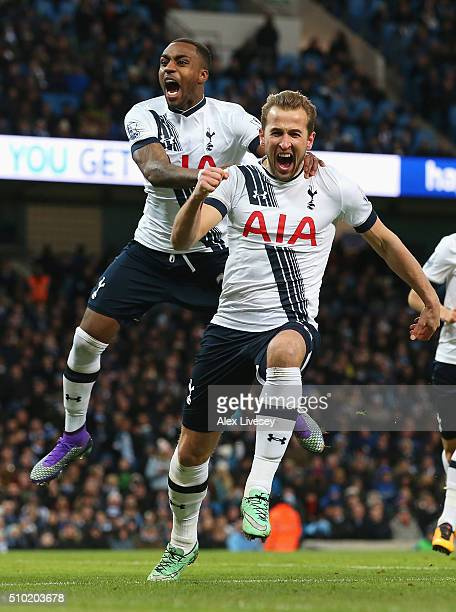 Harry Kane of Tottenham Hotspur celebrates scoring his penalty with Danny Rose during the Barclays Premier League match between Manchester City and...