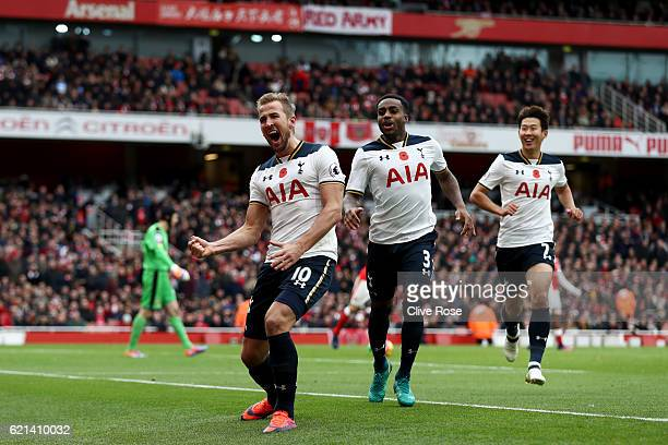 Harry Kane of Tottenham Hotspur celebrates scoring his sides first goal with Danny Rose and HeungMin Son of Tottenham Hotspur during the Premier...