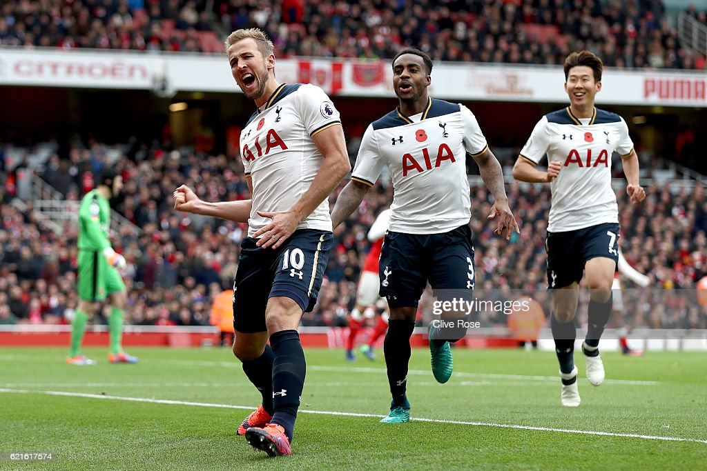 Harry Kane of Tottenham Hotspur celebrates scoring his sides first goal with team mates during the Premier League match between Arsenal and Tottenham Hotspur at Emirates Stadium on November 6, 2016 in London, England.