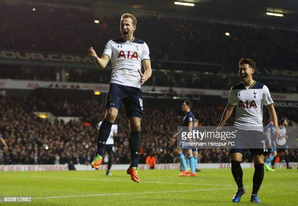 Harry Kane of Tottenham Hotspur celebrates scoring his sides first goal from the penalty spot during the Premier League match between Tottenham...
