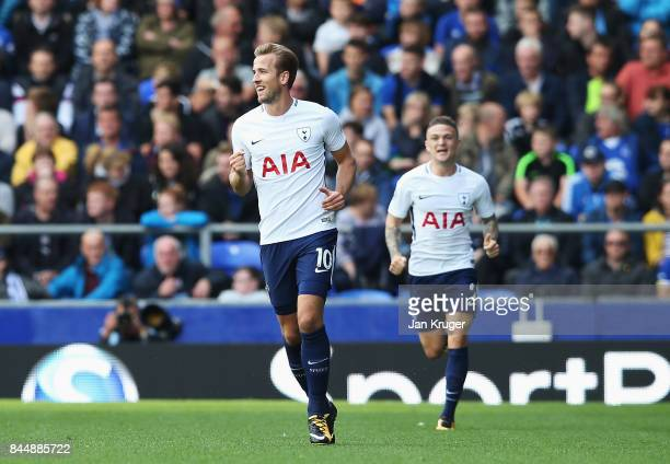 Harry Kane of Tottenham Hotspur celebrates scoring his sides first goal during the Premier League match between Everton and Tottenham Hotspur at...