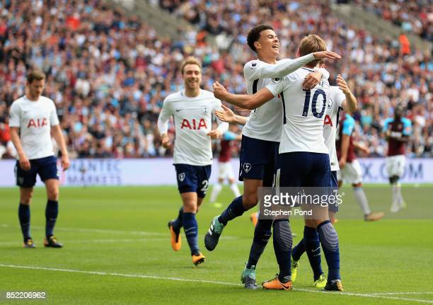 Harry Kane of Tottenham Hotspur celebrates scoring his sides first goal with Dele Alli of Tottenham Hotspur during the Premier League match between...