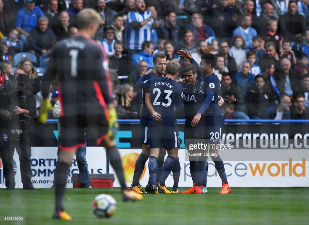 Harry Kane of Tottenham Hotspur celebrates scoring his sides first goal with his Tottenham Hotspur team mates during the Premier League match between Huddersfield Town and Tottenham Hotspur at John Smith's Stadium on September 30, 2017 in Huddersfield, England.