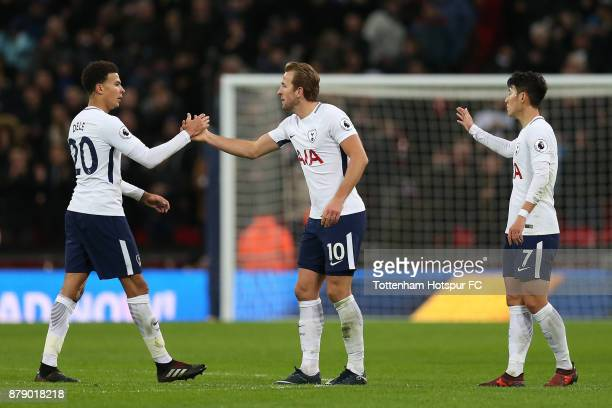 Harry Kane of Tottenham Hotspur celebrates scoring his sides first goal with Harry Kane of Tottenham Hotspur and HeungMin Son of Tottenham Hotspur...