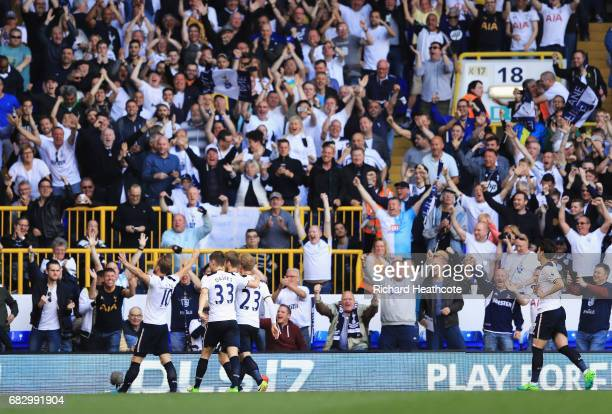 Harry Kane of Tottenham Hotspur celebrates scoring his sides second goal with his Tottenham Hotspur team mates and the Tottenham Hotspur fans during...