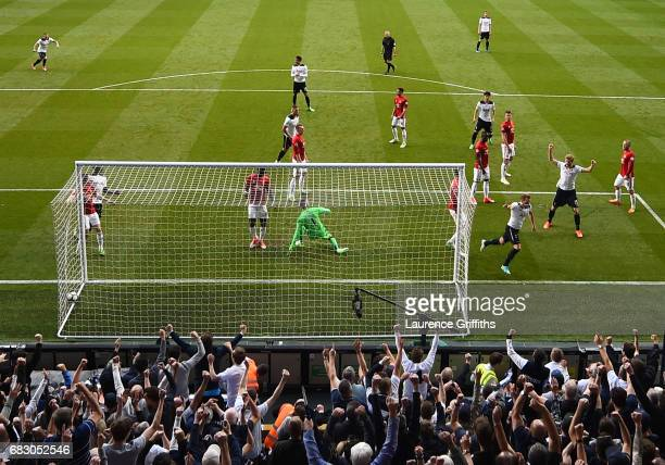 Harry Kane of Tottenham Hotspur celebrates scoring his sides second goal past David De Gea of Manchester United during the Premier League match...